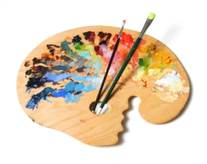 Ergonomic artist's palette with brushes isolated over a white background