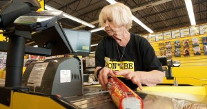 CTDPFF An elderly female employee working at the checkout counter in Jesse & Kelly's No Frills supermarket store Ontario, Canada. Image shot 05/2012. Exact date unknown.