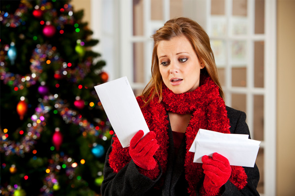 woman-upset-with-christmas-bills