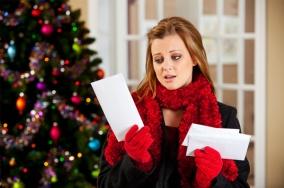woman-upset-with-christmas-bills